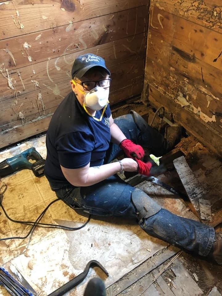 Rebuilding the bathroom floor joists at the future volunteer house.